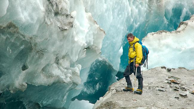 student at the edge of ice cliff