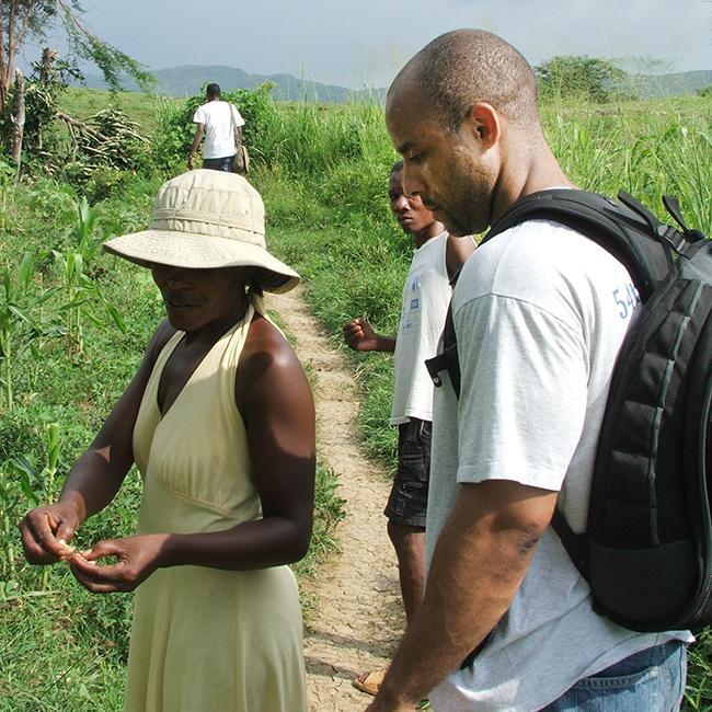 David Walton in field in Haiti (2007 photo)
