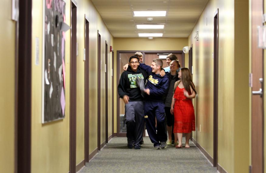 Augustana friends walking up the hallway