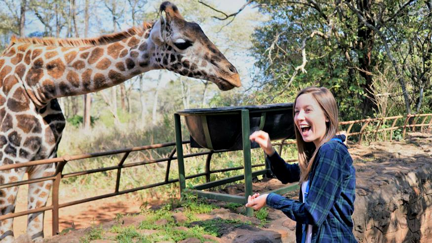 Brenna Whisler and giraffe