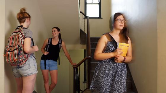 female students in dorm stairwell