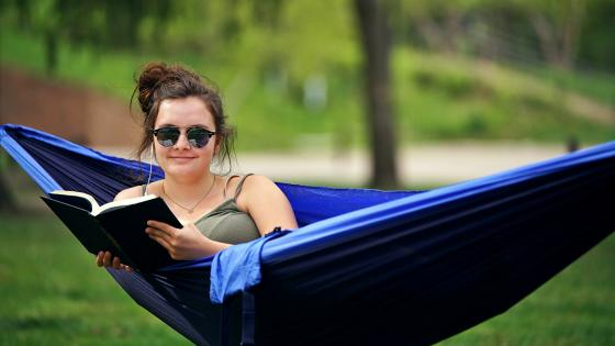 student enjoying summer in a hammock